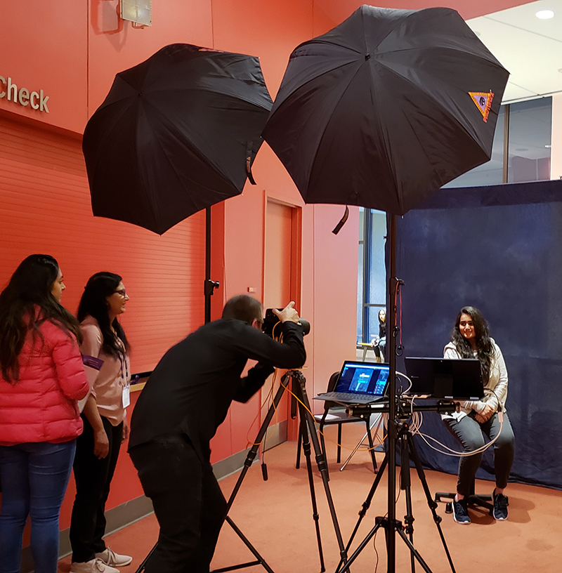 A student getting her professional photograph taken