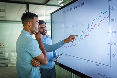Two professionals analyzing and interpreting data