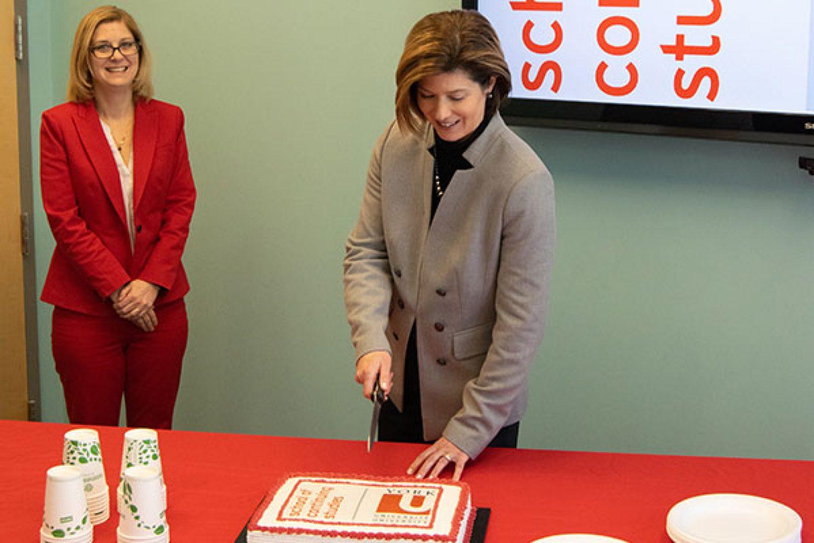 Tracey cutting cake