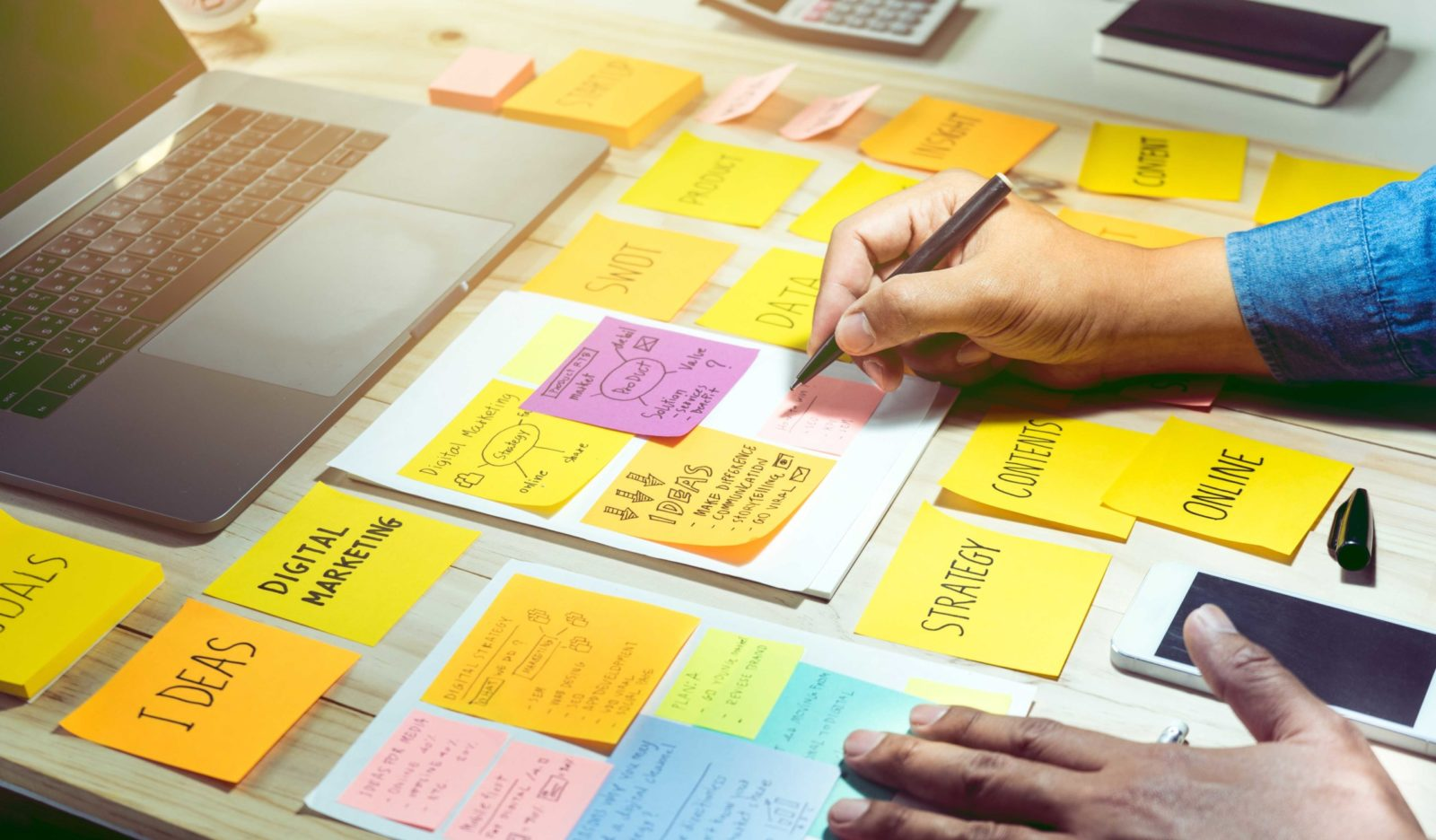businessman working with notepaper of strategy ideas.