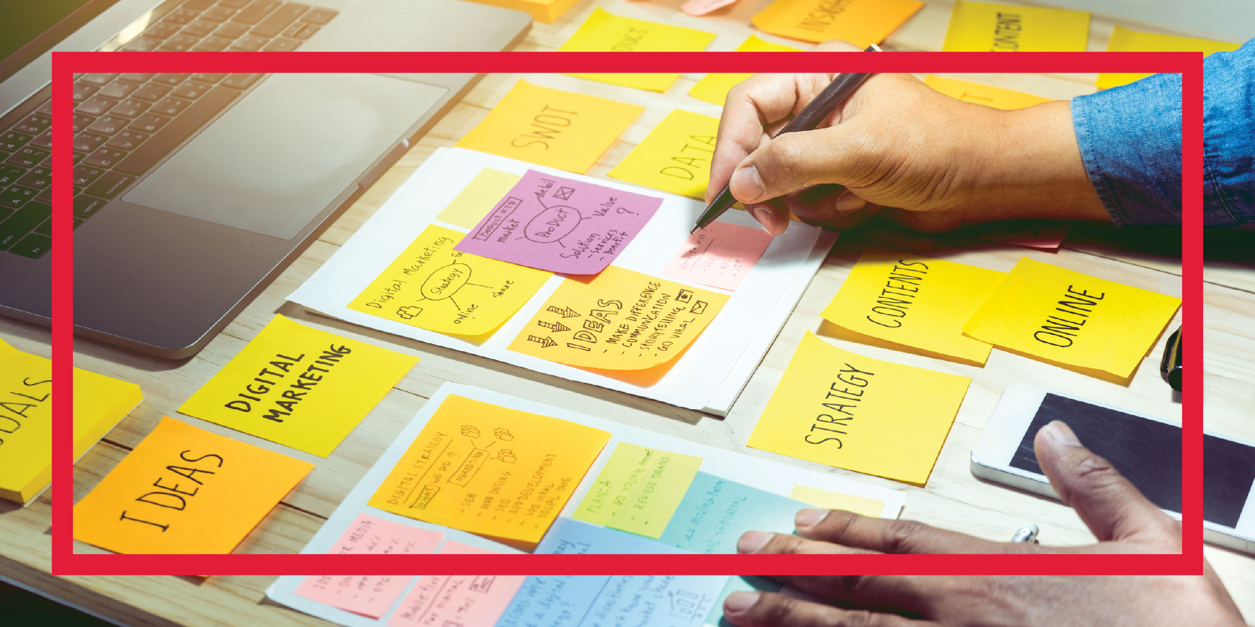Writing creative ideas on sticky notes