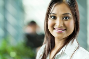 beautiful indian businesswoman close up portrait in office